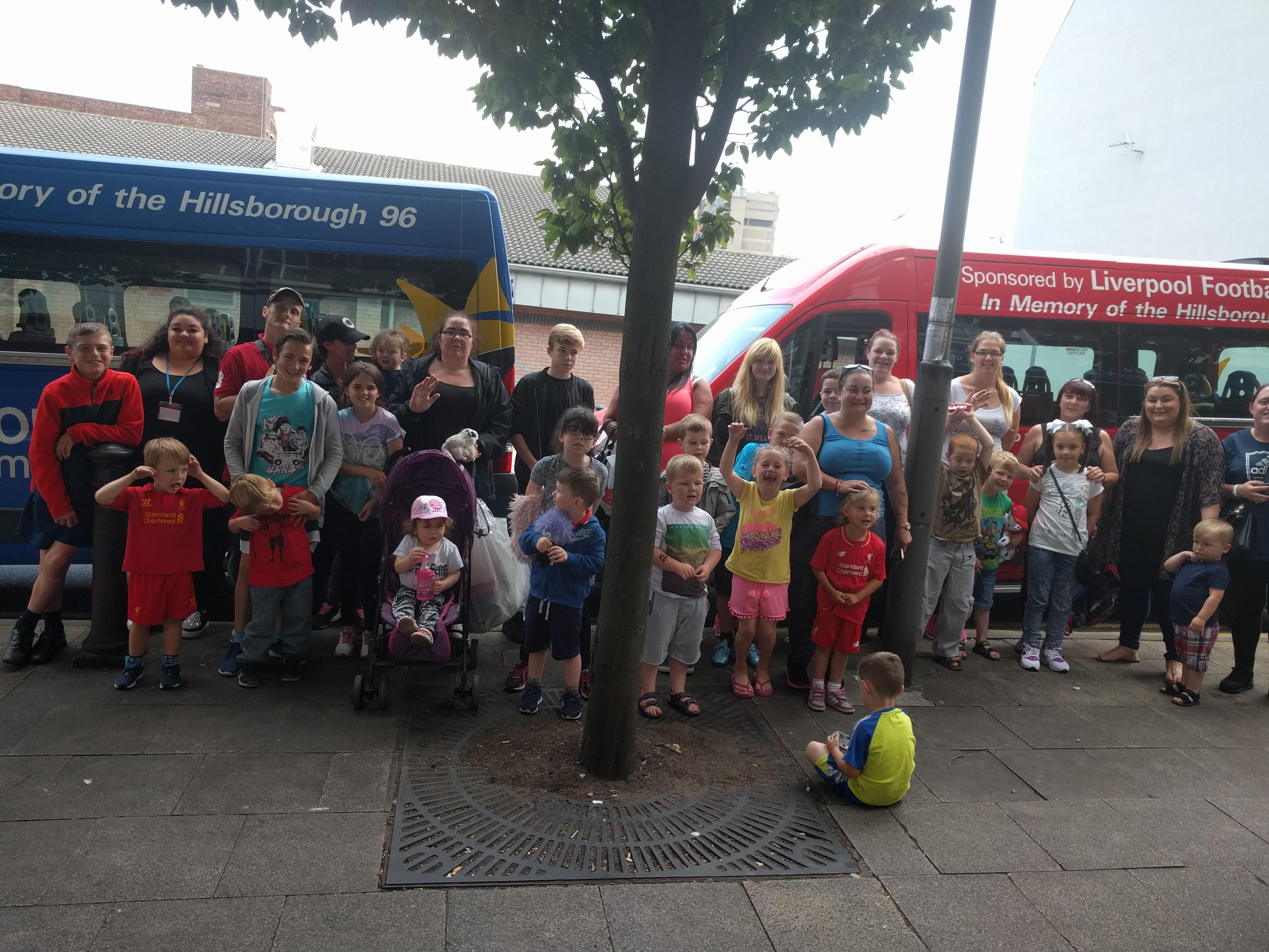 kids outside buses